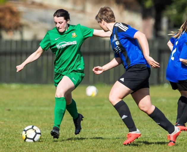Green Island striker Stephanie Lee (left) in action against a Queenstown player. Photo: Adam Binns