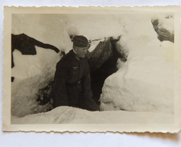 In winter 1942, a fellow soldier took this photo of Ernst, on the Russian front, less than two...