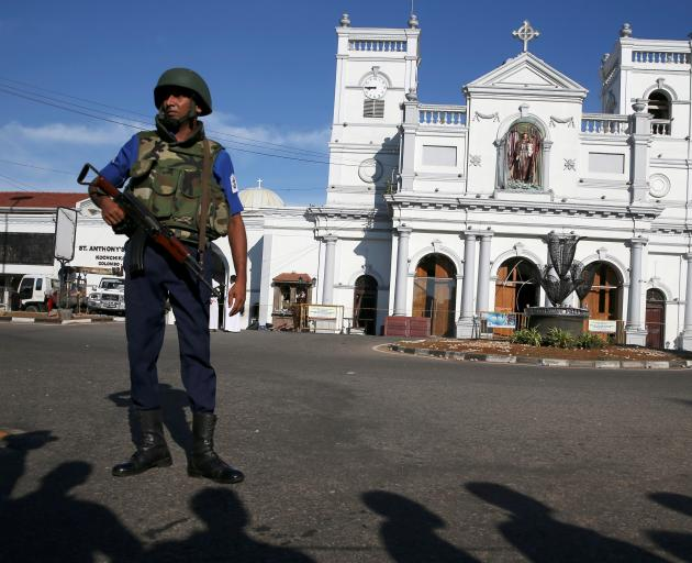 A security officer guards St Anthony's shrine in Colombo. Photo: Reuters