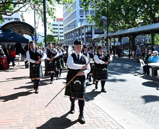 Drum major Andrew McLellan leads the City of Dunedin Pipe Band into the central carriageway of...