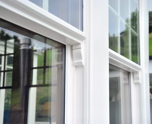 The top sections of the living room sash windows have an exterior double-
