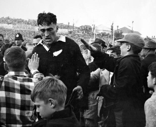 """All Black Stan """"Tiny"""" Hill walks off Eden Park after their test against South Africa in 1956...."""