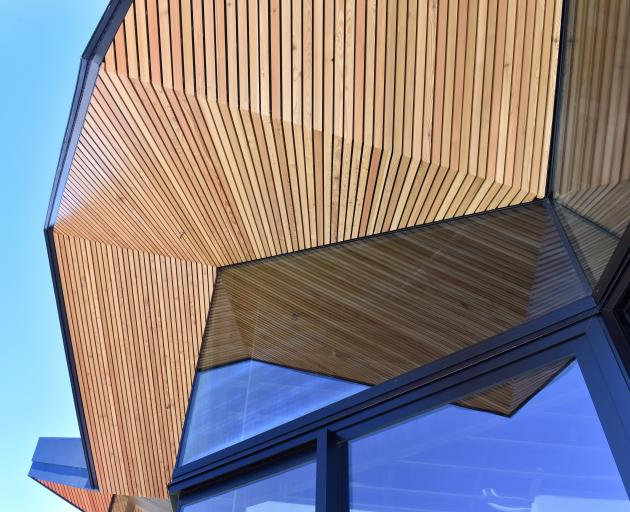Siberian larch extends from the interior to the exterior, blurring the line between inside and out.