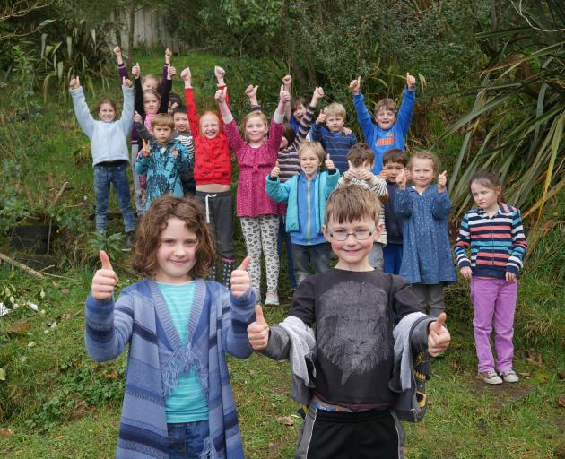 St Leonards School pupils Lucy Riepl (8, front left), Daniel Stephenson (8, front right) and the...