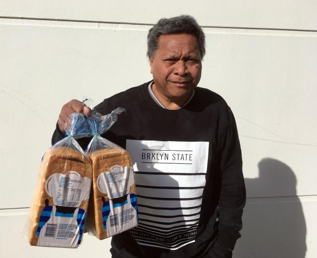 Hotesi Maito, of  Dunedin, buys loaves of toast bread on Friday to feed his sons. PHOTO: SHAWN...