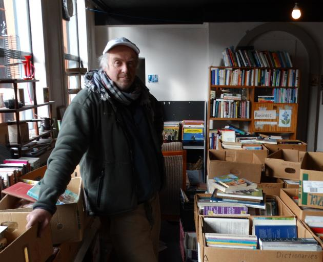 Stafford St bookseller Richard West has the mammoth task of selling or re-homing about 20,000...