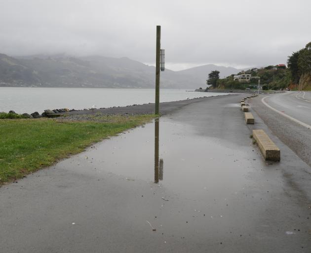 One of the large puddles affecting the ease in which pedestrians and cyclists can use the...