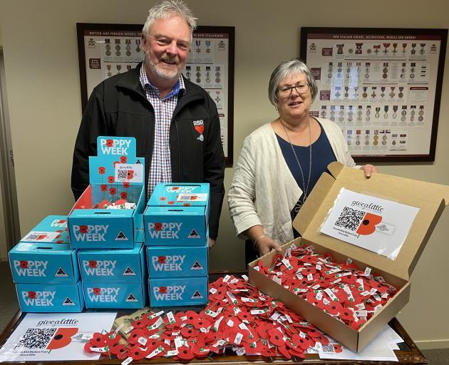 Dunedin RSA welfare officer Niall Shepherd and administrator Sally Turner prepare to distribute...