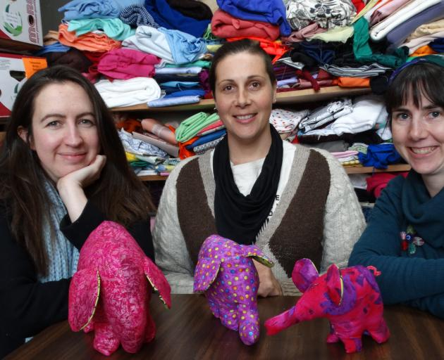Using waste fabric to create 4000 soft toy elephants is an exciting new project for (from left)...