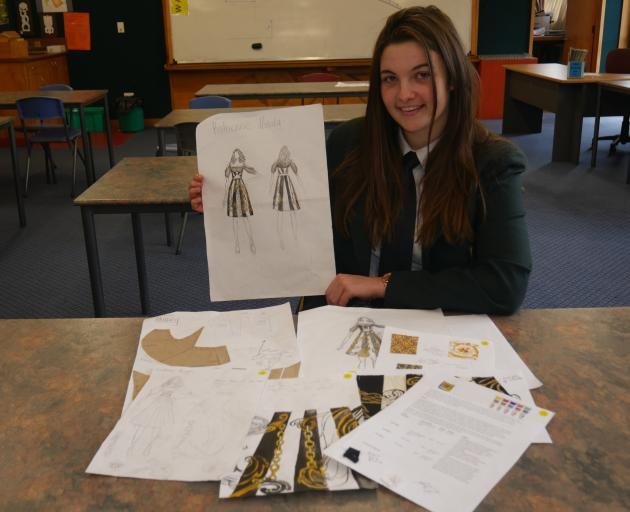 Bayfield High School pupil Charlotte Fuller holds a sketch of a dress that landed her second...