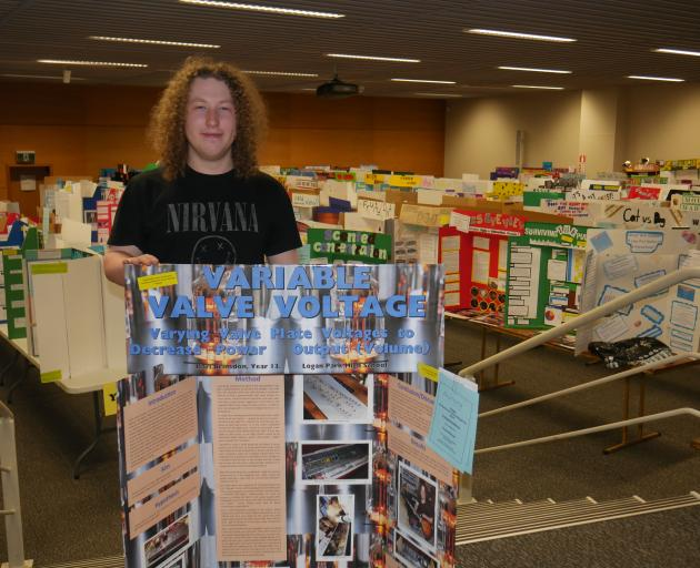 Logan Park High School pupil Karl Brinsdon (17) shows off his project at the Science and...