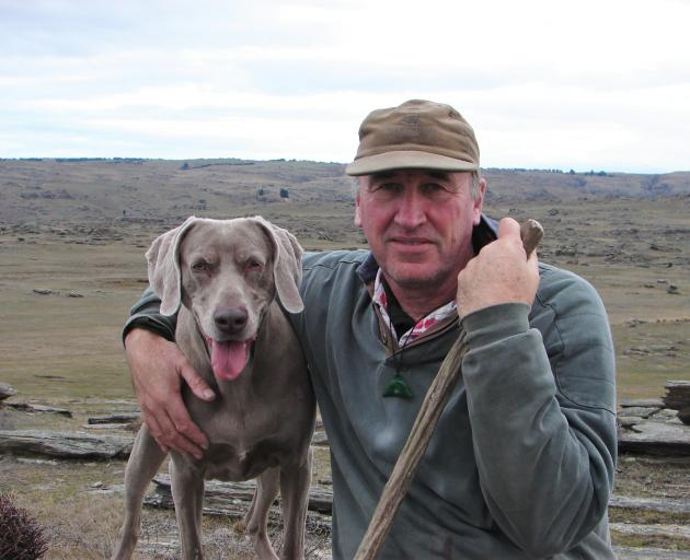 Strath Taieri Community Board member-elect Robin Thomas and his dog Anna on his property,'...