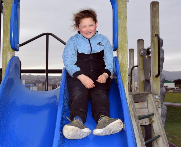 Abigail Dustow returns to a slide in Marlow Park in St Kilda on Monday. It is where she injured...