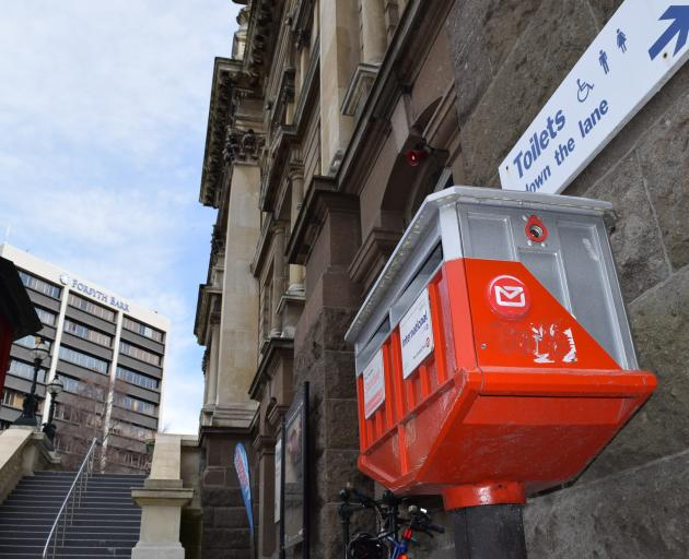 A New Zealand Post post box outside the Municipal Chambers in the upper Octagon yesterday. PHOTO:...
