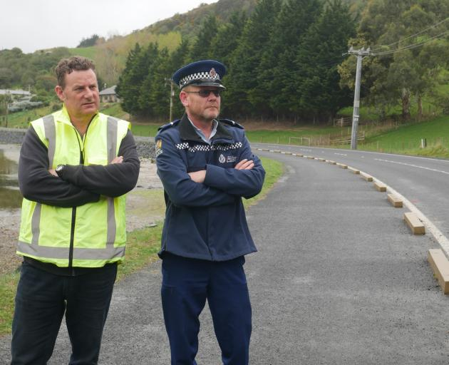 Otago Peninsula Community Board chairman Paul Pope (left) and Senior Constable Aaron Smith are...