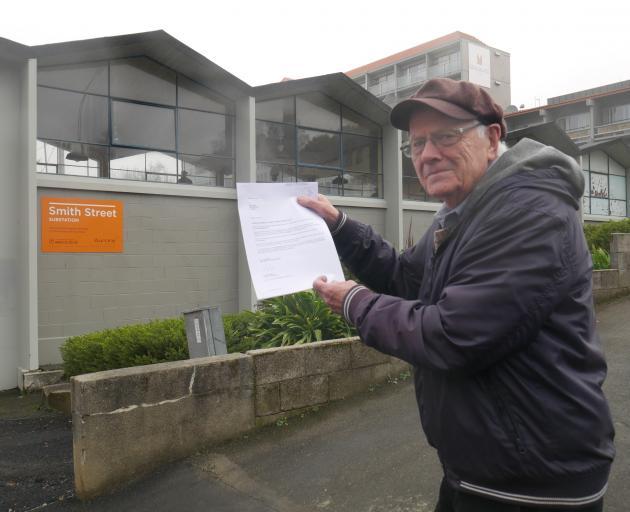 York Pl resident Roy Kenny with the letter he received from Aurora Energy Ltd's lawyer in 2017...
