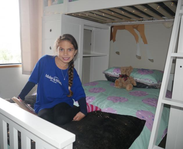 Ariah Gillon-Smith shows off her new loft bed, which she got as part of her bedroom makeover by...