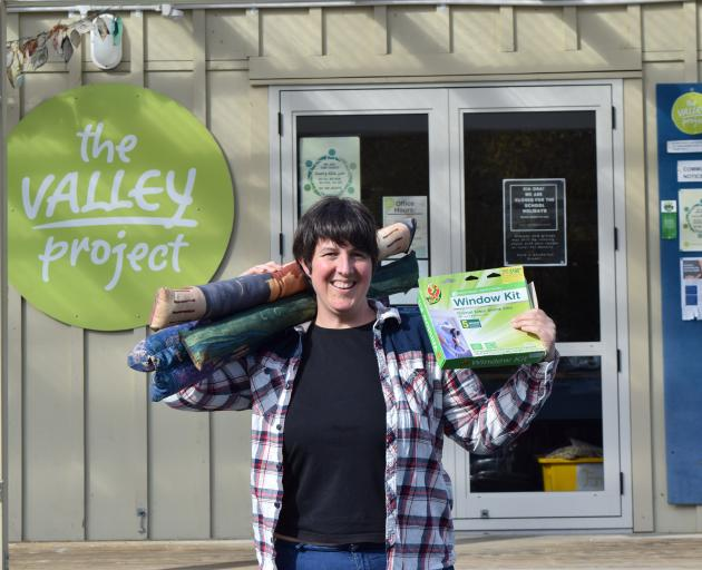 The Valley Project community worker Charlotte Wilson displays draught stoppers and window film to...
