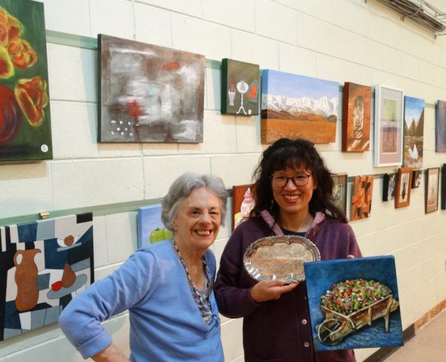 Wakari Art Group member Song Hue (right) accepts the ''people's choice'' award from long-standing...