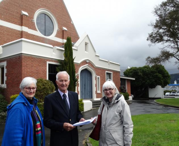 Maori Hill residents Gillian Fleming (left) and Barbara Frame (right) hand over a petition...