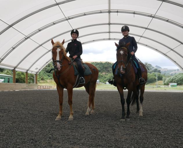 Riding in the covered arena  at Riding for the Disabled last week are Evie Auchinvole (12, left),...
