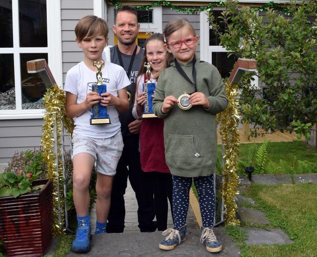 Tim Doidge and his children (from left) Oskar, Anika and Emily display Mr Doidge's body-building...