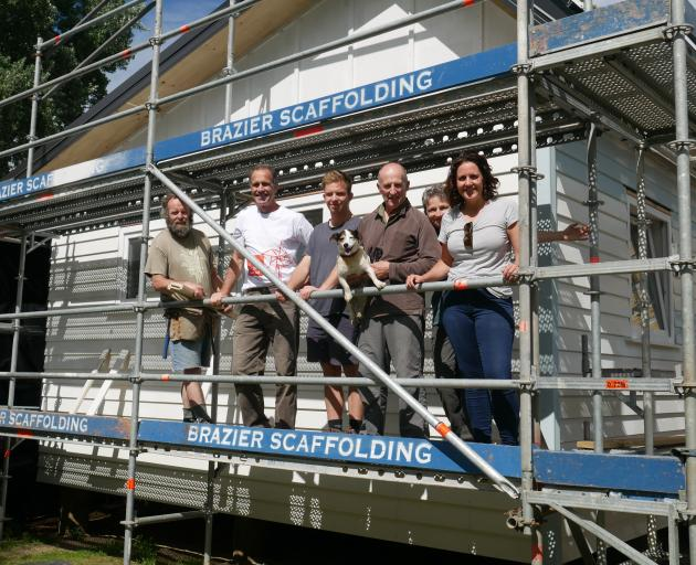 On site at the climate-safe house building site are (from left) volunteer Gerry Thompson,...