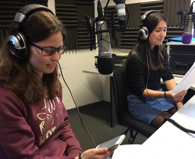 French exchange students Chloe Parfait (16, left) and Clara Mannes (15) create their radio show...