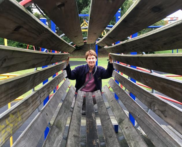 Age Concern Otago falls prevention co-ordinator Margaret Dando inspects play equipment in the...