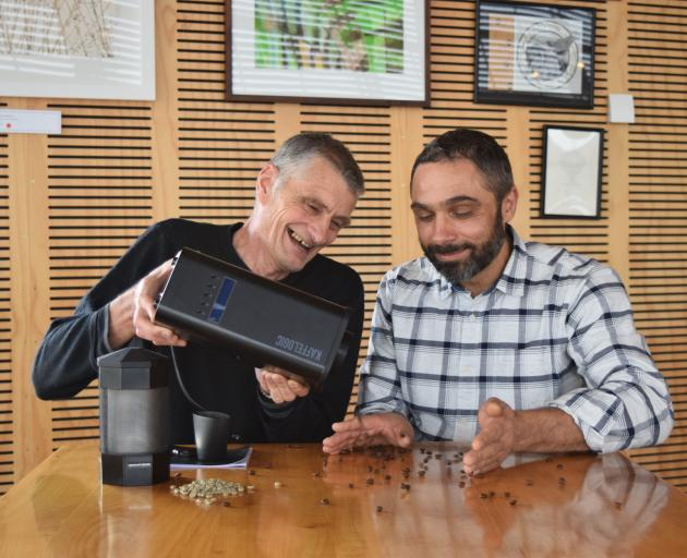 Kaffelogic founder Chris Hilder (left) and Horopito Cafe manager Simon Kitchingman pour roasted...
