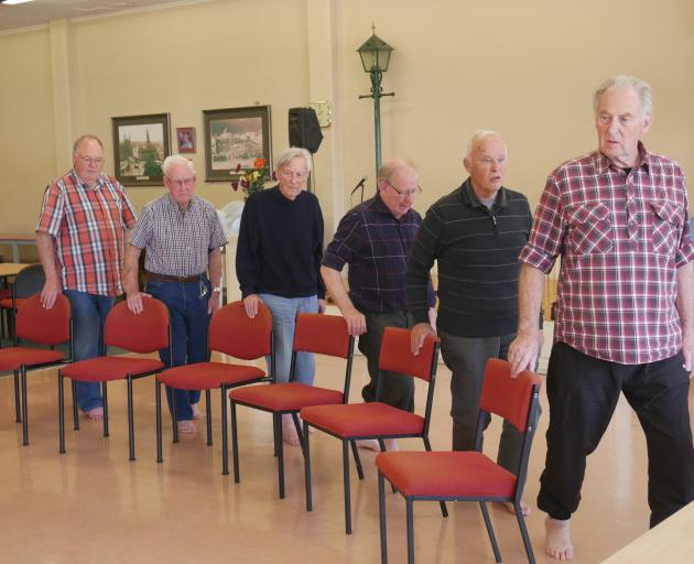 Taking part in a men's exercise class are (from left) Gregor Morgan (77), Ean Leyden (89), Eli...