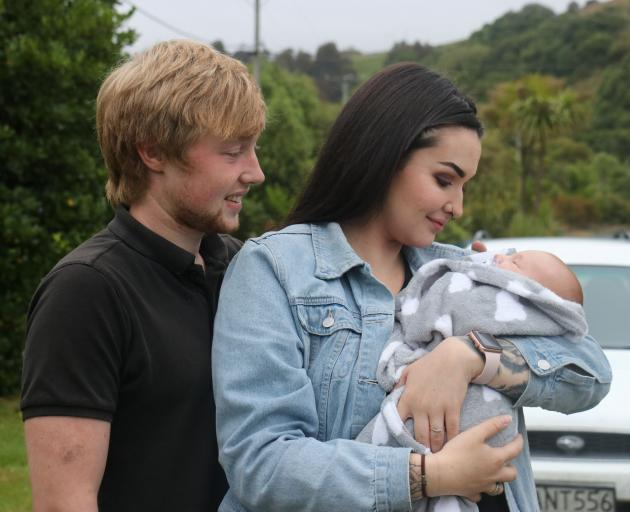 Englishman Troy Thorpe and Kiwi Lu Conroy look fondly at their baby son Leo as they recall a...