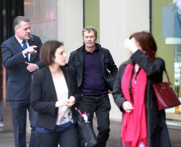 Stephen McKee, centre, outside the Auckland District Court next to his lawyer Paul Wicks QC and...