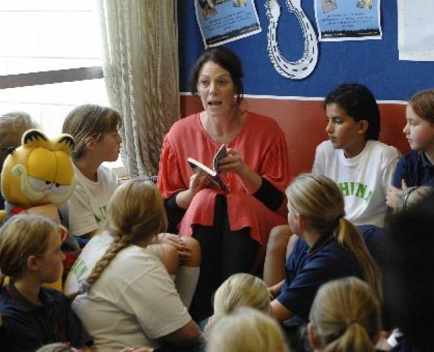 Saddle up . . . Children's author Stacy Gregg reads an excerpt from one of her ``Pony Club Secrets'' books to pupils from Tahuna Intermediate, in the school library. Photo: Linda Robertson