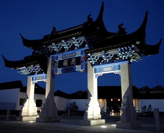 Night illumination brings out detail on the elaborate archway, or Pai Lou, which leads to the...