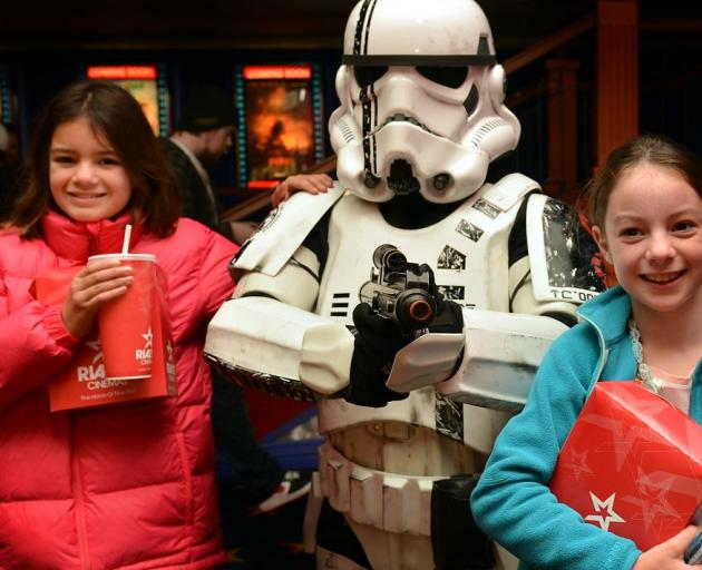 Ngaio (left) and Kiriana Davidson-Duell with Star Wars storm trooper Warren Goodwin during the Star Wars Marathon at the Rialto in Dunedin yesterday.  Photo by Peter McIntosh.