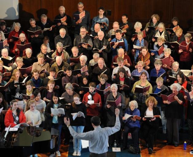 David Burchell conducts the City Choir Dunedin and Columba Junior Madrigal Choir during a rehearsal for Saturday's Knox Church concert. Photo by Craig Baxter