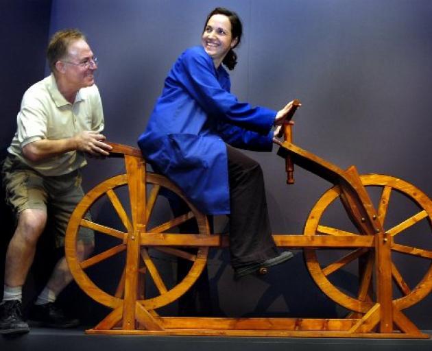 Exhibition manager Luigi Rizzo and exhibition designer Michelle Michael set up the museum's da Vinci exhibit.  Photo by Jane Dawber