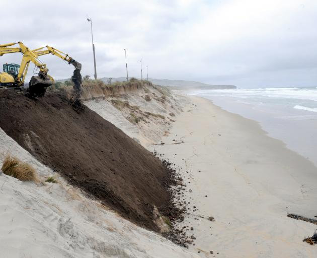 Diggers dump sand on to an area of  Dunedin's Middle Beach subject to recent erosion. Photo by...