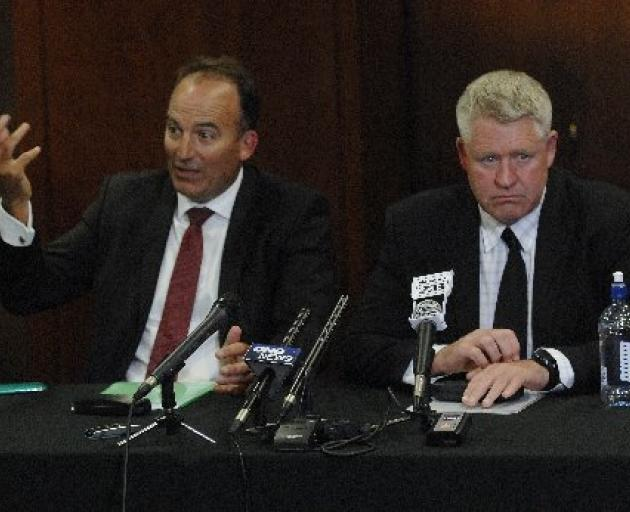 ORFU chairman Wayne Graham (left) and NZRU chief executive Steve Tew break the news to supporters...