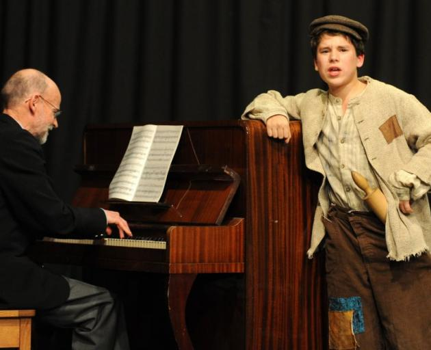 Pianist Richard Warnock plays and Alexander McAdam (13), of Dunedin, sings at the 67th Annual Junior Vocal Competition at the Mosgiel Coronation Hall on Saturday. Photo by Craig Baxter.