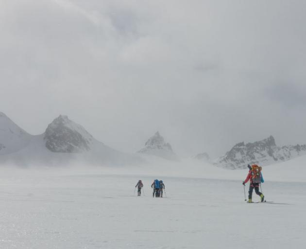 The team approaches the Trident Mountains, the scene of the famous Shackleton bum slide. PHOTO: TOM MACTAVISH