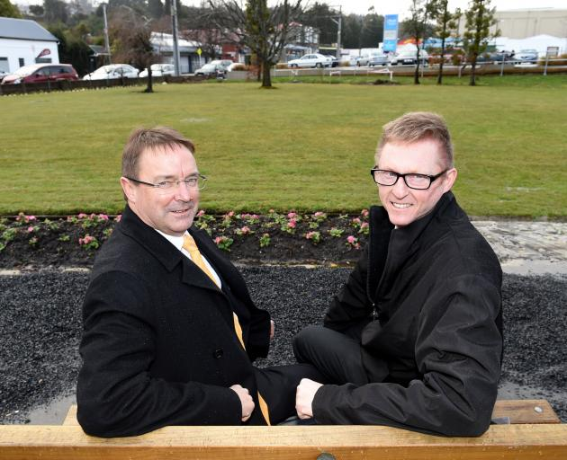 Greater Green Island Community Network chairman Steve Hayward (left) and Fresh Choice Green Island supermarket owner John Moyle examine the site of a proposed playground in Green Island. Photo by Gregor Richardson.