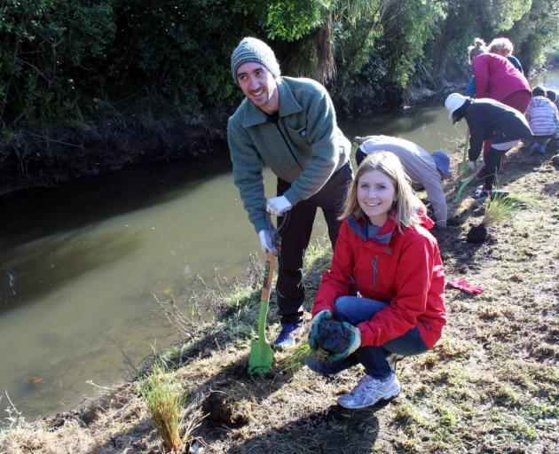 Sonya Lewthwaite and husband Jon Screech plant out the banks of a stream in Waiwhetu, Lower Hutt,...