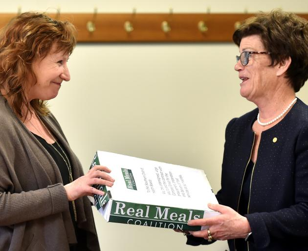 Dunedin South MP Clare Curran hands a petition asking the SDHB to dump the Compass food contract...
