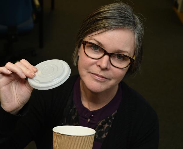 Dunedin City Council waste manager Catherine Irvine holds up a coffee cup lid which cannot be...