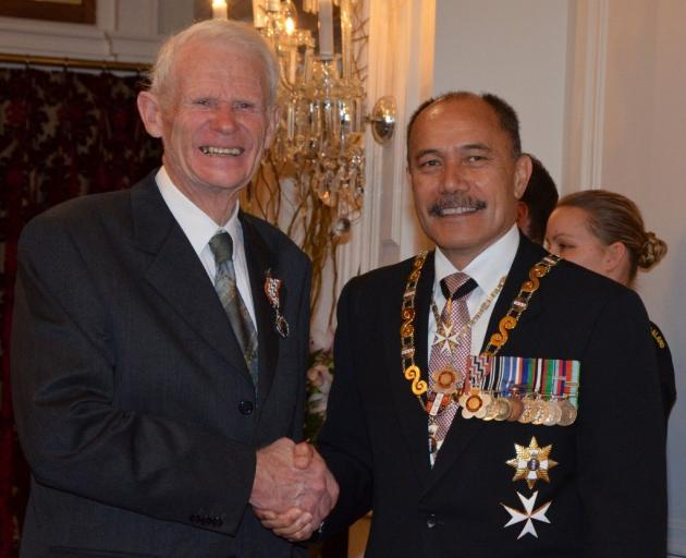 Peter Willsman accepting a Queen's Service Medal for services to conservation and the Queenstown...
