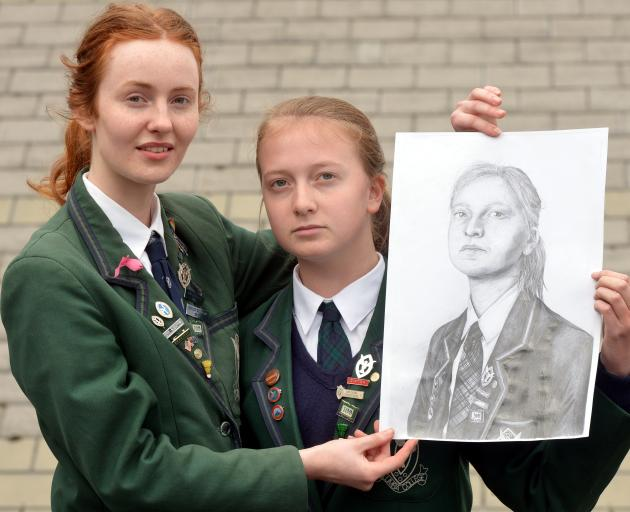 Columba College artist Lily Van Buskirk (left) with her pencil drawing of fellow pupil Ashleigh...