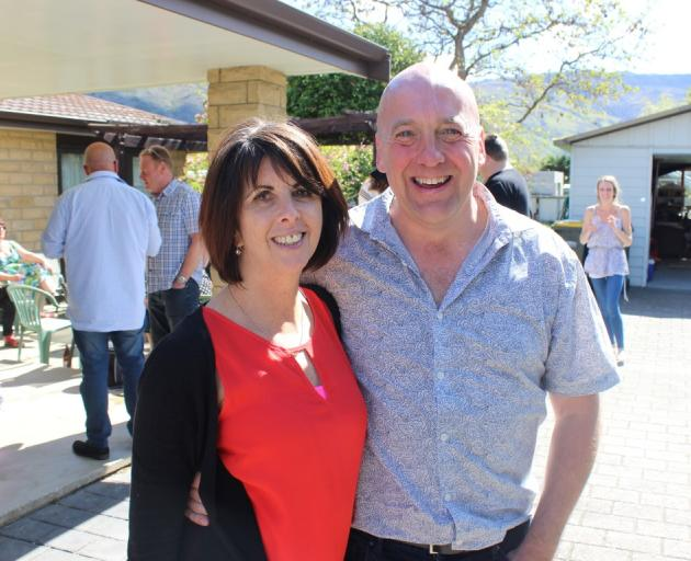 Newly-elected Central Otago mayor Tim Cadogan and wife Linda celebrate the win with friends and...