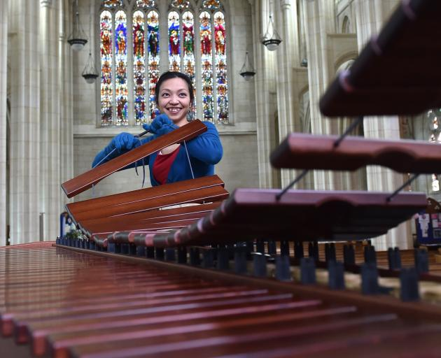 Musician Yoshiko Tsurutu sets up her marimba at St Paul's Cathedral yesterday for her Arts...